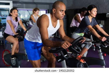Man ride stationary bike in a fitness club