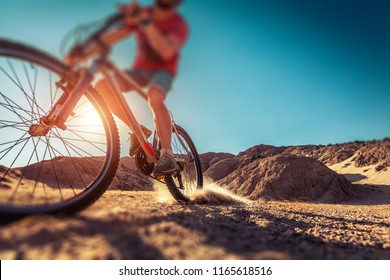 Man rides bicycle in the desert. Tilt shift effect applied