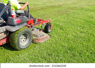 A man rides a lawn mower. Lawn Care. Riding Mower. Grass