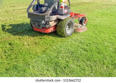 A man rides a lawn mower. Lawn Care. Riding Mower. Grass