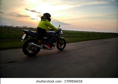 man rides a motorcycle on the road
