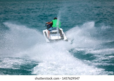 A man rides a water bike in the water. Summer vacation at sea