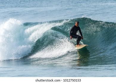 Man rides wave with good shape. Taken January 21, 2018. Location Veterans Park Redondo Beach, California.