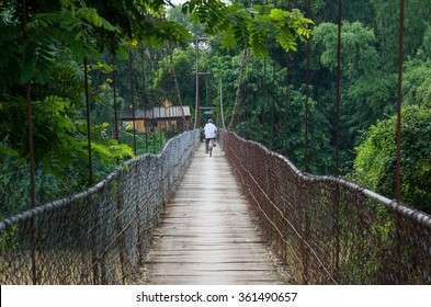 Man riding bicycle crosses the bridge in Battambang/Cambodia.