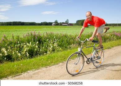 Man riding a bicycle on a funny way