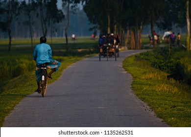 Man riding a bicycle in an urban road in Bangladesh unique photo