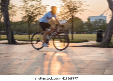 man riding bicycles on a city park street ,Intentional motion blur