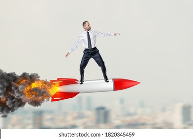 man riding a big missile over the city. motivation and success concept.