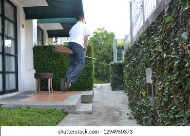 a man riding a broom at the hotel