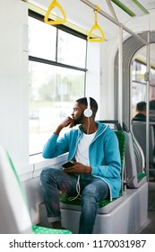 Man Riding In Bus Listening Music In Headphones