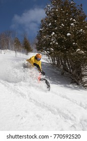 Man riding a fat bike in powder snow during winter