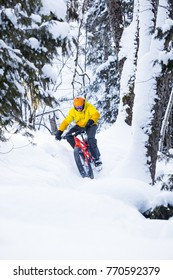 Man riding a fat bike in the snow during winter