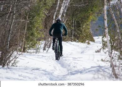 Man riding a fat bike in winter