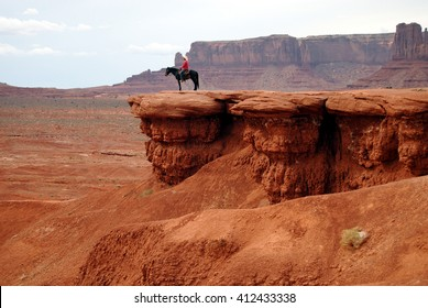 Man riding a horse at John Ford's point, Monument Valley