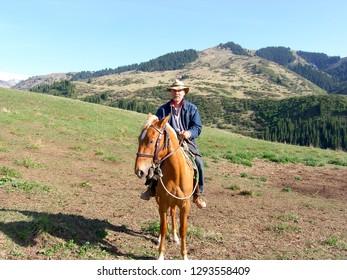 man riding a Mongolian horse
