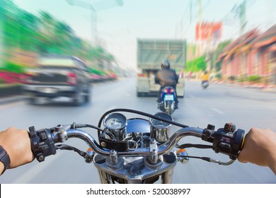 A man riding a motorcycle, motion image of accident will happen as background.