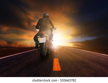 man riding motorcycle on road for traveling lifestyle
