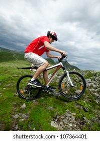 A man riding a mountain bike