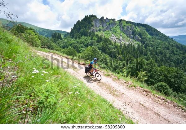 man riding mountain bike on the road