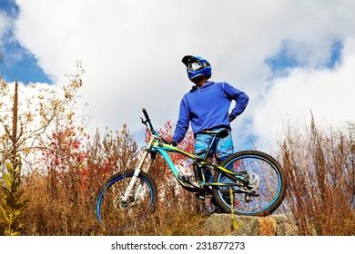 man riding a mountain bike outdoor. mountain bike