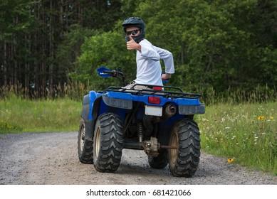 Man riding on an Atv on a trail, Ontario, Canada.