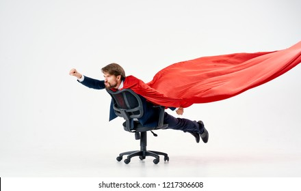 man riding on a chair with a red sheet