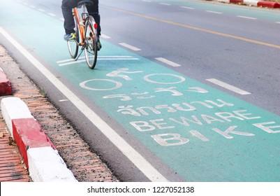 Man riding on the designated bike lane in Ayutthaya, Thailand.