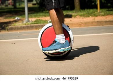 Man riding on electric unicyle