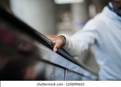 Man riding on an escalator