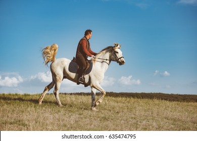 man riding on horse