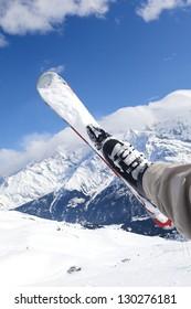 Man riding on skis fall down