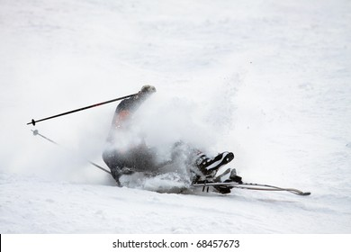 Man riding on skis fall down, he could break something.