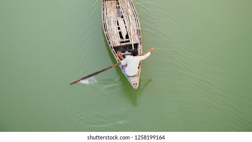Man riding on a traditional boat in the river unique photo