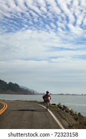 A man riding a recumbent bike down the street in Bolinas, CA