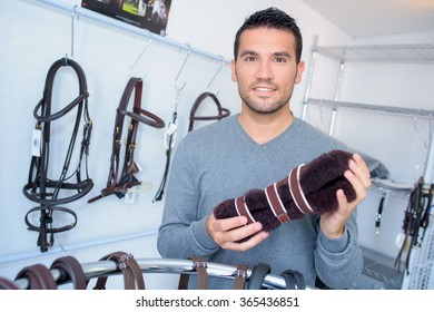 man in riding shop