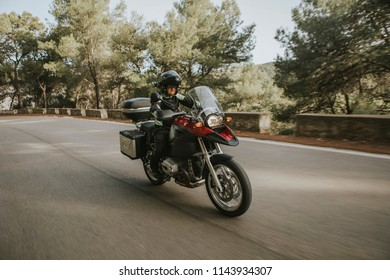 Man riding a touring motorbike during a trip across the mountains.