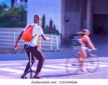 man riding uni cycle