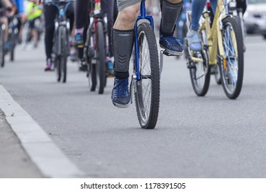 A man is riding a unicycle on the road