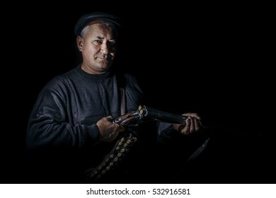 Man with rifle isolated on black background