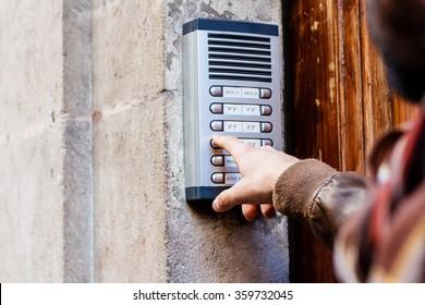 Man ringing the doorbell on the street