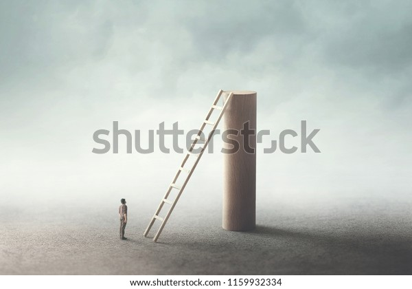 man rise stairs to reach the top of the tower