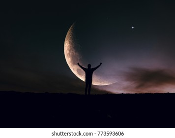 man rising hands under the moon  / Night sky landscape with moon and stars