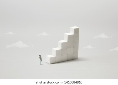 man rising stairs to reach the top of the tower