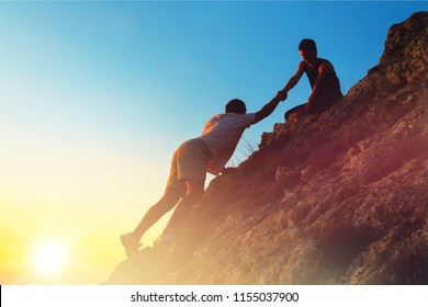 Man Rock Climbing with another, Man Helping concept