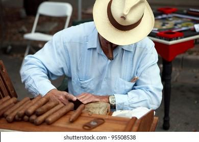 Man rolling cigars.
