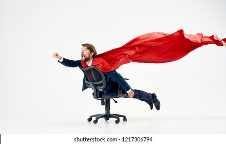 man rolls on a chair with a red sheet