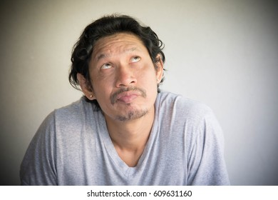 Man in room on gray background,Asian man expression
