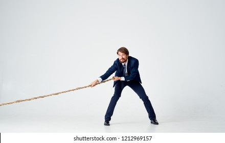 a man of rope is assiduously pulling the rope
