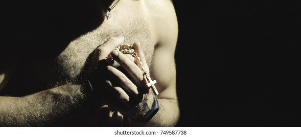 a man with rosaries