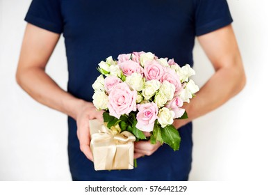 a man with roses and the gift. gift for a women